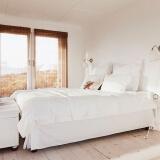 欣沁 一次性无纺布床单 旅行酒店隔脏卫生床上用品 密封便携式 2.2*2.2m 9元
